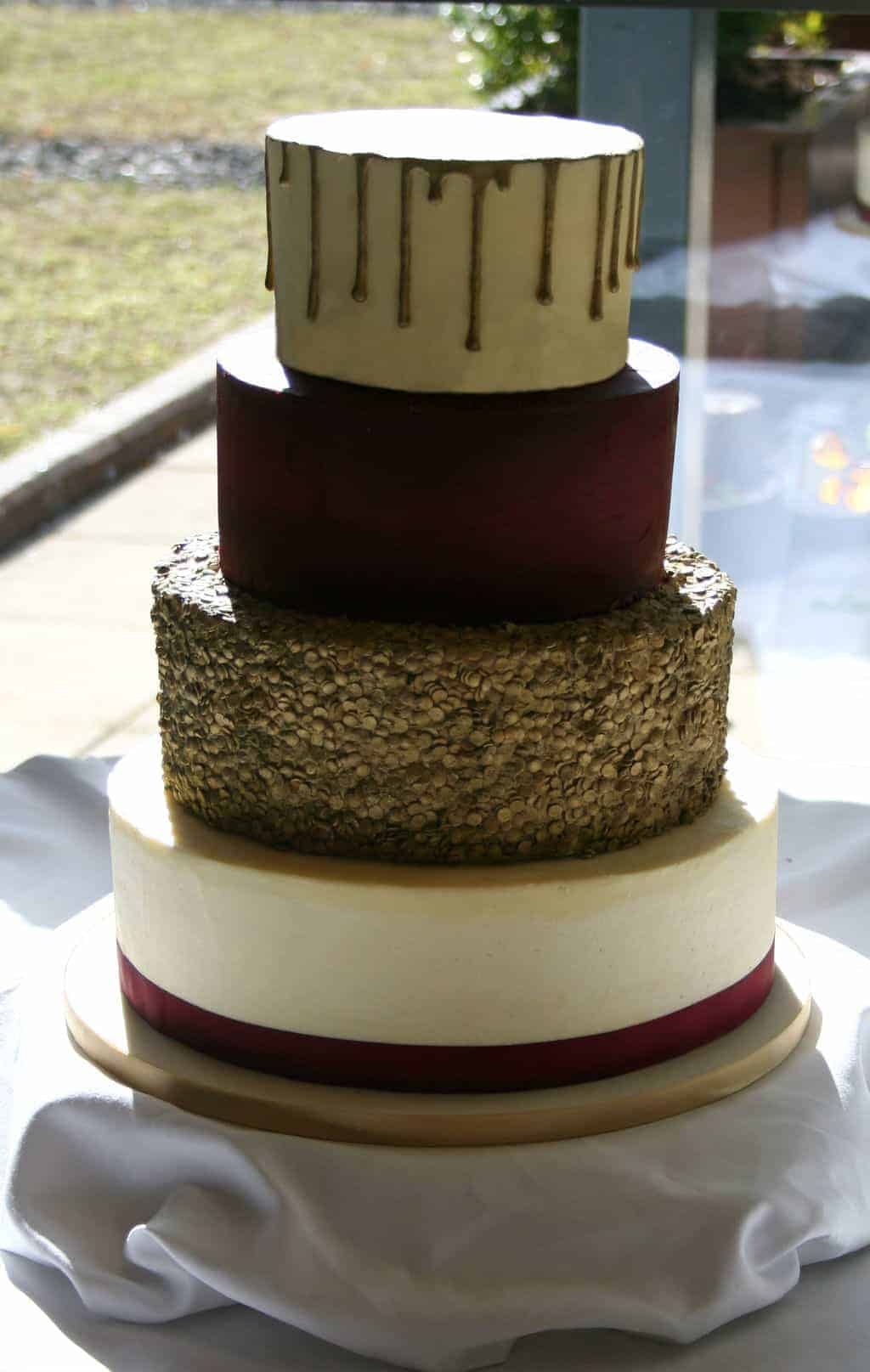 burgundy and gold wedding cake wedding cake designers bakers amp decorators 12229